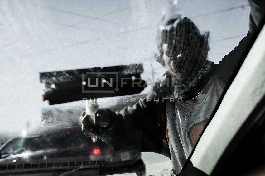 A migrant is washing cars windshields in the street of Tijuana for a living. Tijuana, Mexico. Jan 06, 2015.