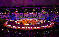 """27 JUL 2012 - LONDON, GBR - NHS staff and volunteers perform a jive during the """"Second To The Right, And Straight On Till Morning"""" section of the Opening Ceremony of the London 2012 Olympic Games in the Olympic Stadium in the Olympic Park, Stratford, London, Great Britain (PHOTO (C) 2012 NIGEL FARROW)"""