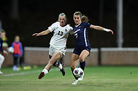 CHAPEL HILL, NC - NOVEMBER 29: Julia Dorsey #7 of the University of North Carolina plays the ball away from Tara McKeown #13 of the University of Southern California during a game between University of Southern California and University of North Carolina at UNC Soccer and Lacrosse Stadium on November 29, 2019 in Chapel Hill, North Carolina.