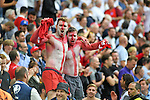 English football fans celebrate at full time after England beat Wales at the Stade Bollaert-Delelis in Lens, France this afternoon during their Euro 2016 Group B fixture.