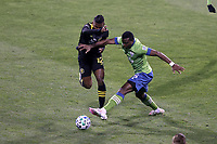 COLUMBUS, OH - DECEMBER 12: Nouhou Tolo #5 of the Seattle Sounders FC and Luis Diaz #12 of the Columbus Crew challenge for the ball during a game between Seattle Sounders FC and Columbus Crew at MAPFRE Stadium on December 12, 2020 in Columbus, Ohio.