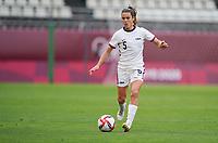 KASHIMA, JAPAN - JULY 27: Kelley O'Hara #5 of the United States moves with the ball during a game between Australia and USWNT at Ibaraki Kashima Stadium on July 27, 2021 in Kashima, Japan.