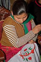 Dehradun, India.  Woman Doing Embroidery at Tasmia Academy, an Islamic Institution Teaching Sewing Skills to Indian Women.
