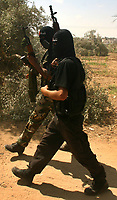 """Palestinians miltants friend  of Emad Abu Ahjayer,  Leader of Alqassam Brigads loyal Hamas movement during his funeral in the Bureij refugee camp, central Gaza Strip, Thursday, Sept. 21, 2007. Israeli troops operating against rocket squads in Gaza .""""photo by Fday Adwan"""""""