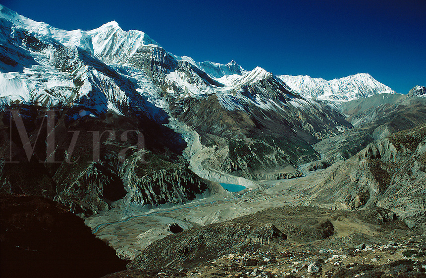 .The Manang valley from above Manang village, with the peaks Gangapurna (left) and Tilicho peak, west-central Nepal...