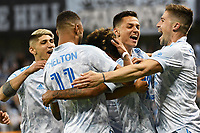 KANSAS CITY, KS - MAY 29: Sporting KC players celebrate Gianluca Busio's equalizer during a game between Houston Dynamo and Sporting Kansas City at Children's Mercy Park on May 29, 2021 in Kansas City, Kansas.