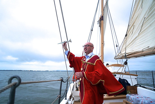 Admiral of all he surveys - the Mayor of Limerick, Councilor Michael Collins, re-asserts his ancient role and privileges of the Admiral of the Shannon Estuary with a silver dart into the sea while still in the Estuary, on passage aboard Ilen from Limerick to Galway last Friday evening
