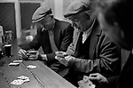 County Kerry,  Ireland Eire 1969,  friends playing card game in village pub. 1960s
