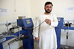 2 June 2013,  Jalalabad, Afghanistan.   Khalid Abdurahim of the Engineering Faculty at Nangarhar University in Jalalabad shows off some equipment that has broken down since purchase and neglected to be repaired due to lack of technical support . Many of the facilities and equipment at the University are being provided under the World Bank funded Strengthening Higher Education Program ( SHEP). The objective of the program is to restore basic operational performance at a group of core universities in Afghanistan. It aims to act as a catalyst to attract resources at Afghan tertiary education in the long term.  SHEP is the first major education investment in Afghanistan by the World Bank. In 2008 it received $US 5 million from ARTF to expand infrastructure and equipment to Universities in Kabul, Nangarhar , Balkh and Kandahar.  Picture by Graham Crouch/World Bank