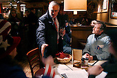 Hanover, New Hampshire.USA.January 25, 2004..Democratic presidential candidate General Wesley Clark greets people in restaurant in hopes of getting votes.