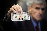 Self-proclaimed Democrat-turned-Republican Trump supporter Jerry Lambert holds up a doctored Dollar bill sign with the likeness of Donald J. Trump, at a rally with Mike Pence, Vice-presidential candidate for the Republican Party, in Bensalem, PA.