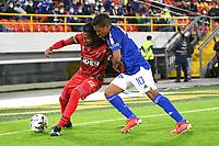 BOGOTÁ- COLOMBIA, 06-09-2021:Harrison Mojica de Millonarios disputa el balón con Jorge Posada de Patriotas Boyacá durante partido por la fecha 8 entre Millonarios  y Patriotas Boyaca como parte de la Liga BetPlay DIMAYOR II 2021 jugado en el estadio Nemesio Camacho El Campín  de la ciudad de Bogotá / Harrison Mojica of Millonarios vies for the ball with  Jorge Posada player of Patriotas Boyaca during match for the date 8 between Millonarios  and Patriotas Boyaca as a part BetPlay DIMAYOR League II 2021 played at Nemesio Camacho El Campin stadium in Bogota city. Photo: VizzorImage / Samuel Norato  / Contribuidor