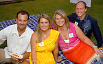 From left: Jay and Kathryn Jenkins with Michelle and Craig Thomas at the SEARCH picnic at Discovery Green Park Friday evening Sept. 25,2009. (Dave Rossman/For the Chronicle)