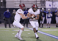 Springdale Bulldogs Junior Landon Phipps (5) hands off to Springdale Bulldogs Senior Gilberto Dominguez (22) during the game against the Rogers Mountaineers Friday, October 16, 2020, at Whitey Smith Stadium, Rogers, Arkansas (Special to NWA Democrat-Gazette/Brent Soule)