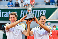 Nicolas MAHUT of France and Pierre Hugues HERBERT of France celebrate their victory with the trophy during the tenth round of Roland Garros tennis open at Roland Garros in Paris, France on Saturday, 12 June, 2021. Photo by Baptiste Fernandez / Icon Sport