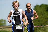 26 MAY 2013 - BRIGG, GBR - Visually impaired competitor Jack Garner (left) (Junior 18-19) of Lincsquad and his guide Pete Chappill finish the 2013 Brigg Bomber Quadrathlon, a World Quadrathlon Federation World Cup round and the British Championships, Brigg in Lincolnshire, Great Britain (PHOTO (C) 2013 NIGEL FARROW)