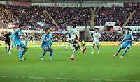 SWANSEA, WALES - FEBRUARY 07: Bafetimbi Gomis of Swansea (3rd L) attempts to get the ball Sunderland players during the Premier League match between Swansea City and Sunderland AFC at Liberty Stadium on February 7, 2015 in Swansea, Wales.