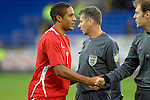 International Friendly match between Wales and Scotland at the new Cardiff City Stadium : Wales Captain Ashley Williams shakes the hand of referee Cyril Zimmermann.