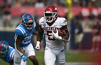 Arkansas running back Raheim Sanders (5) carries the ball, Saturday, October 9, 2021 during the third quarter of a football game at Vaught Hemingway Stadium in Oxford, Miss. Check out nwaonline.com/211010Daily/ for today's photo gallery. <br /> (NWA Democrat-Gazette/Charlie Kaijo)