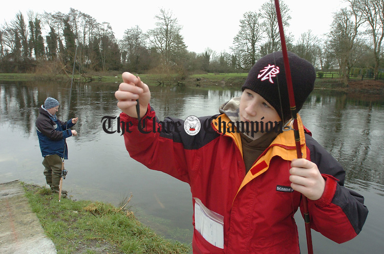 Like father Like son............... Young Aaron Guilfoyle and his father Tommy take to the banks of the Fergus in Ennis on the first day of the Salmon Season. Photograph by John Kelly.