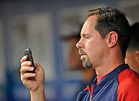 24 July 2012: Washington Nationals athletic trainer Lee Kuntz checks messages in the dugout prior to a game against the New York Mets at Citi Field in Flushing, NY. The Nationals defeated the Mets 5-2 to take the second game of their 3-game series. Mandatory Credit: Ed Wolfstein Photo