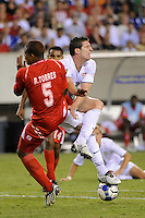 Kenny Cooper (17) of the United States (USA) is fouled by Roman Torres (5) of Panama (PAN) in the penalty box during overtime. The United States (USA) defeated Panama (PAN) 2-1 during a quarterfinal match of the CONCACAF Gold Cup at Lincoln Financial Field in Philadelphia, PA, on July 18, 2009.