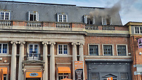 BNPS.co.uk (01202) 558833. <br /> Pic: CorinMesser/BNPS<br /> <br /> Pictures: Smoke in the early stages of the fire. <br /> Fire fighters attend the scene of a serious blaze in Bournemouth town centre this afternoon. <br /> <br /> The fire, which appeared to start in a third floor flat, spread through the roof of the building engulfing much of the town in smoke.
