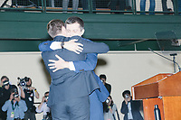 Democratic presidential candidate and former South Bend, Ind., mayor Pete Buttigieg embraces husband Chasten Buttigieg after speaking at his Primary Night rally at Nashua Community College in Nashua, New Hampshire, on Tue., Feb. 11, 2020. Democratic presidential candidate and Vermont senator Bernie Sanders was projected to win the New Hampshire Democratic Primary, but Buttigieg came in a close second.