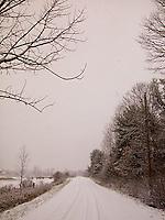 Car tracks on snowy country road&#xA;<br />