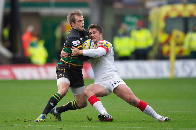 20121027 Copyright onEdition 2012©.Free for editorial use image, please credit: onEdition..Stephen Myler of Northampton Saints is tackled by Brad Barritt of Saracens during the Aviva Premiership match between Northampton Saints and Saracens at Franklin's Gardens on Saturday 27th October 2012 (Photo by Rob Munro)..For press contacts contact: Sam Feasey at brandRapport on M: +44 (0)7717 757114 E: SFeasey@brand-rapport.com..If you require a higher resolution image or you have any other onEdition photographic enquiries, please contact onEdition on 0845 900 2 900 or email info@onEdition.com.This image is copyright the onEdition 2012©..This image has been supplied by onEdition and must be credited onEdition. The author is asserting his full Moral rights in relation to the publication of this image. Rights for onward transmission of any image or file is not granted or implied. Changing or deleting Copyright information is illegal as specified in the Copyright, Design and Patents Act 1988. If you are in any way unsure of your right to publish this image please contact onEdition on 0845 900 2 900 or email info@onEdition.com
