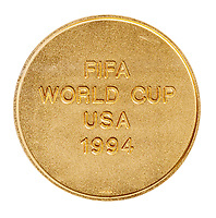 BNPS.co.uk (01202 558833)<br /> Pic: Julien'sAuctions/BNPS<br /> <br /> Pictured: Alfredo Di Stefano 1994 FIFA World Cup USA Commemorative Gold Coin.<br /> <br /> An epic collection of medals, trophies, shirts and personal items relating to footballing legend Alfredo Di Stefano is being sold by his family for over £1m.<br /> <br /> Many of the awards won by the great goalscorer have, until recently, been on display at the Real Madrid Museum, the club where he played for most of his career.<br /> <br /> The Argentine-born striker is regarded as one of the best players of all-time and is often compared to Cristiano Ronaldo.<br /> <br /> During Di Stafano's time with Real Madrid in the 1950s and '60s, the Spanish giants dominated European football, largely due to his goals and assists.