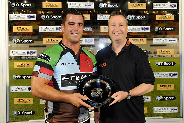20130803 Copyright onEdition 2013 ©<br /> Free for editorial use image, please credit: onEdition.<br /> <br /> John Stainsby from J.P. Morgan Asset Management presents the plate for the winning team to Dave Ward captain of Harlequins 7s during the J.P. Morgan Asset Management Premiership Rugby 7s Series.<br /> <br /> The J.P. Morgan Asset Management Premiership Rugby 7s Series kicks off for the fourth season on Thursday 1st August with Pool A at Kingsholm, Gloucester with Pool B being played at Franklin's Gardens, Northampton on Friday 2nd August, Pool C at Allianz Park, Saracens home ground, on Saturday 3rd August and the Final being played at The Recreation Ground, Bath on Friday 9th August. The innovative tournament, which involves all 12 Premiership Rugby clubs, offers a fantastic platform for some of the country's finest young athletes to be exposed to the excitement, pressures and skills required to compete at an elite level.<br /> <br /> The 12 Premiership Rugby clubs are divided into three groups for the tournament, with the winner and runner up of each regional event going through to the Final. There are six games each evening, with each match consisting of two 7 minute halves with a 2 minute break at half time.<br /> <br /> For additional images please go to: http://www.w-w-i.com/jp_morgan_premiership_sevens/<br /> <br /> For press contacts contact: Beth Begg at brandRapport on D: +44 (0)20 7932 5813 M: +44 (0)7900 88231 E: BBegg@brand-rapport.com<br /> <br /> If you require a higher resolution image or you have any other onEdition photographic enquiries, please contact onEdition on 0845 900 2 900 or email info@onEdition.com<br /> This image is copyright the onEdition 2013©.<br /> <br /> This image has been supplied by onEdition and must be credited onEdition. The author is asserting his full Moral rights in relation to the publication of this image. Rights for onward transmission of any image or file is not granted or implied. Changing or deleting Copyright information is illegal as specified in the Copyright, Design and Patents Act 1988. If you a
