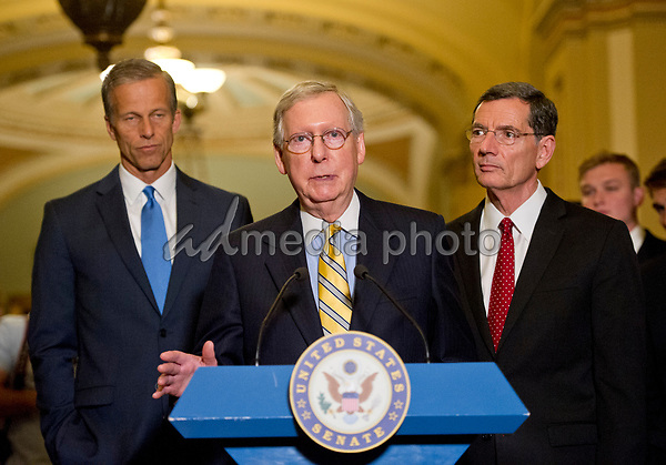 United States Senate Majority Leader Mitch McConnell (Republican of Kentucky) speaks to reporters following the Republican Party luncheon in the United States Capitol in Washington, DC on Tuesday, June 27, 2017.  In his remarks, Leader McConnell announced there would be no vote on the GOP healthcare plan this week. From left to right: US Senator John Barrasso (Republican of Wyoming), Leader McConnell, and US Senator John Thune (Republican of South Dakota). Photo Credit: Ron Sachs/CNP/AdMedia