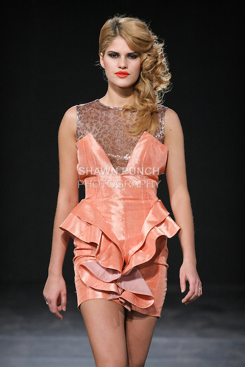 Models walk runway in a Berrys Couture Summer 2011 outfit by Hadiza Yakubu, during Couture Fashion Week Fall 2011 in New York.