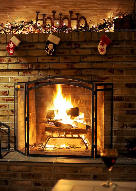 A warm fire illuminates the Christmas decor and a seasonal beverage.  Rehoboth Beach, Delaware, USA.