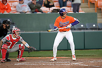 Center fielder Bryce Teodosio (13) of the Clemson Tigers bats in a game against the Stony Brook Seawolves on Friday, February 21, 2020, at Doug Kingsmore Stadium in Clemson, South Carolina. The Seawolves catcher is John Tuccillo (45). Clemson won, 2-0. (Tom Priddy/Four Seam Images)