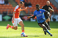 Blackpool's Jerry Yates under pressure from Swindon Town's Diallang Jaiyesimi<br /> <br /> Photographer Kevin Barnes/CameraSport<br /> <br /> The EFL Sky Bet League One - Blackpool v Swindon Town - Saturday 19th September 2020 - Bloomfield Road - Blackpool<br /> <br /> World Copyright © 2020 CameraSport. All rights reserved. 43 Linden Ave. Countesthorpe. Leicester. England. LE8 5PG - Tel: +44 (0) 116 277 4147 - admin@camerasport.com - www.camerasport.com