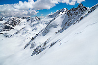 The Ortler Group in northern Italy is a popular region for spring ski touring using the huts for overnights to ski all the many peaks in the mountain group. Skiing the Punta Pedranzini, 3599 meters.
