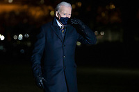 US President Joe Biden responds to a question from the news media after he stepped off Marine One on the South Lawn of the White House in Washington, DC, USA, 17 February 2021. President Biden returns to the White House following a town hall meeting.<br /> Credit: Shawn Thew / Pool via CNP /MediaPunch