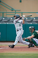 Dartmouth Big Green right fielder Matt Feinstein (23) follows through on a swing in front of catcher Tyler Dietrich (38) during a game against the USF Bulls on March 17, 2019 at USF Baseball Stadium in Tampa, Florida.  USF defeated Dartmouth 4-1.  (Mike Janes/Four Seam Images)