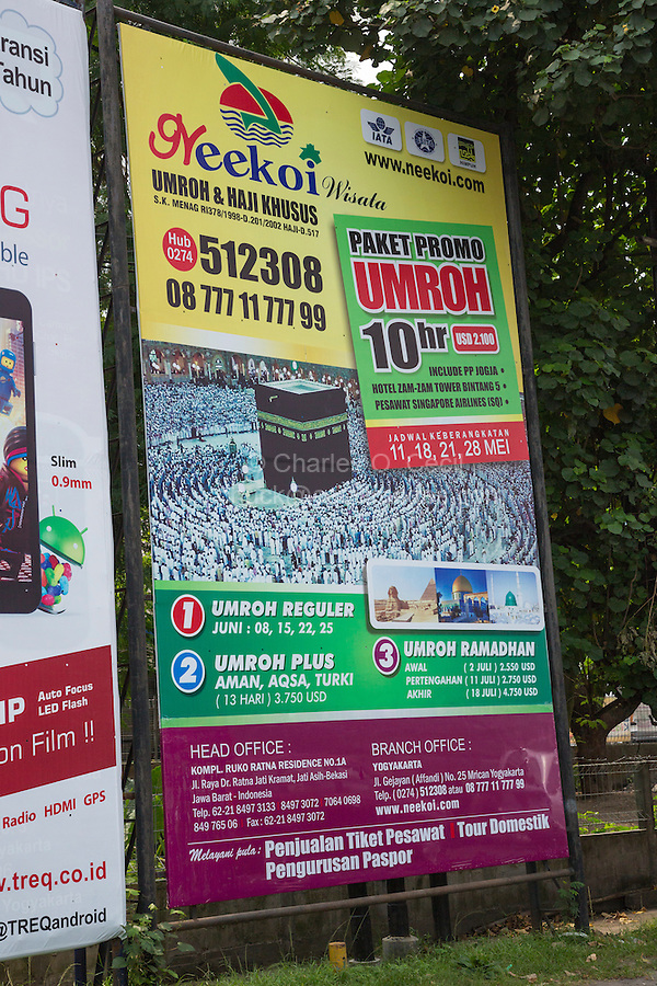 """Yogyakarta, Java, Indonesia.  Travel  Advertisement for the Umrah, the """"Lesser Pilgrimage"""" to Mecca, performed outside the month of Dhu al-Hijjah."""