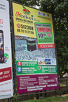"Yogyakarta, Java, Indonesia.  Travel  Advertisement for the Umrah, the ""Lesser Pilgrimage"" to Mecca, performed outside the month of Dhu al-Hijjah."