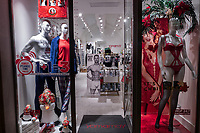 Italy. Basilicata Region. Matera. A YamamaY store sells the latest fashion in underwear, swimwear and clothing for women, men and kids. Human mannequins behind the shop window. Body of sexy woman in red lingerie. A poster of a naked muscular Cristiano Ronaldo posing for his CR7 underwear fashion brand. Cristiano Ronaldo dos Santos Aveiro (born 5 February 1985) is a Portuguese professional footballer who plays as a forward. Often considered as one of the best player in the world, Ronaldo has a record-tying five Ballon d'Or awards. Yamamay is a brand of underwear belonging to Gruppo Pianoforte Holding SpA owned by the Cimmino and Carlino families. Yamamay branded products are mostly distributed through franchising in over 600 stores worldwide. On 17th October 2014, Matera was declared Italian host of European Capital of Culture for 2019. Basilicata is a region in Southern Italy. 7.12.18  © 2018 Didier Ruef