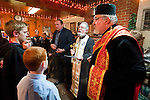Christmas Eve Vigil Service at St. Sava Serbian Orthodox Church, Jackson, Calif.  Yule Log (badnjak) ceremony. Fr. Steve and Deacon Triva recite the blessing