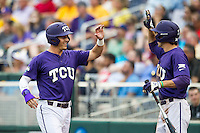 TCU Horned Frogs third baseman Derek Odell (5) is greeted by teammate Jeremie Fagnan (32) (1) after scoring against the LSU Tigers in Game 10 of the NCAA College World Series on June 18, 2015 at TD Ameritrade Park in Omaha, Nebraska. TCU defeated the Tigers 8-4, eliminating LSU from the tournament. (Andrew Woolley/Four Seam Images)