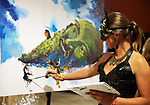 Dozens of artists from around the state of Nevada including Talia Koval, painting live at the annual Capital Collage in Carson City, Nev., on Friday, October 27, 2017. <br /> Photo by Lance Iversen/Nevada Momentum