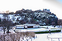The Ross Bandstand and Edinburgh Castle are blanketed in snow. Edinburgh gets its first snow in the first Covid Winter. Edinburgh has been placed in Tier 4 restrictions due to the Covid-19 pandemic.