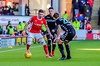 Barnsley's midfielder Adam Hammill (7) held up by Leeds United's defender Gaetano Berardi (28) during the Sky Bet Championship match between Barnsley and Leeds United at Oakwell, Barnsley, England on 25 November 2017. Photo by Stephen Buckley / PRiME Media Images.