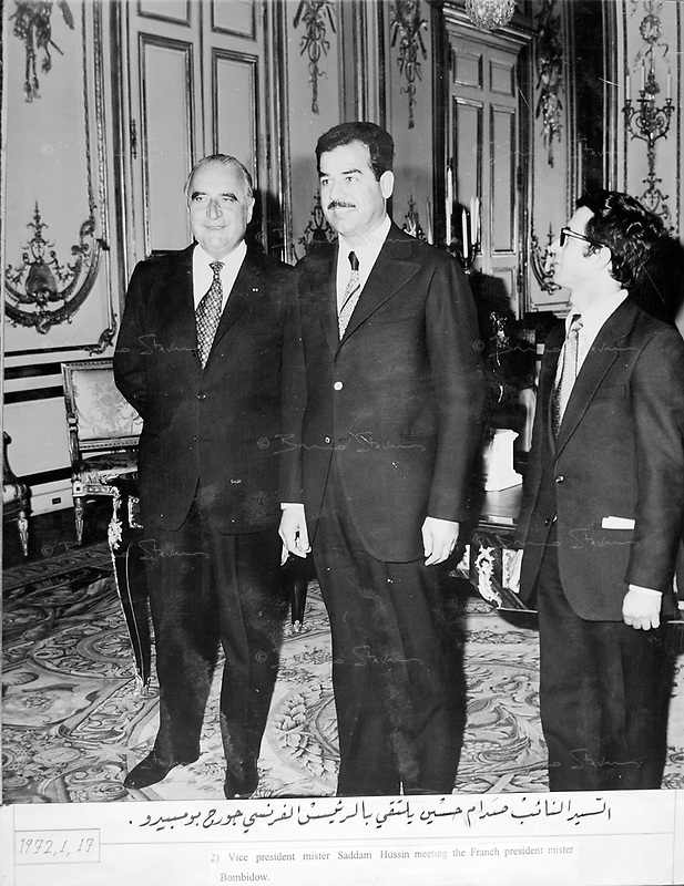 """Paris, France, January 17, 1972..Saddam Hussein received by French President Georges Pompidou.Photograph recovered by Bruno Stevens in the looted """"Triumphant Leader"""" museum in Baghdad, entirely dedicated to the glory of Saddam Hussein."""