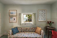 BNPS.co.uk (01202 558833)<br /> Pic: RichardDowner/TheCoastalHouse/BNPS<br /> <br /> Pictured: The living room.<br /> <br /> An off-grid beachside 'oasis' that has no mains water or electricity is on the market for £550,000.<br /> <br /> The former coastguard cottage is the ultimate retreat for those looking to get away from the modern world - with an outside toilet, 'gravity' shower and no wi-fi.<br /> <br /> It is one of three cottages, built by Napoleonic prisoners of war, above the remote National Trust-owned Mansands Beach, between Kingswear and Brixham in Devon.<br /> <br /> The two-bedroom cottage has spectacular panoramic views of the sea and the South Devon coastline and the three properties also share access to a private cove below.